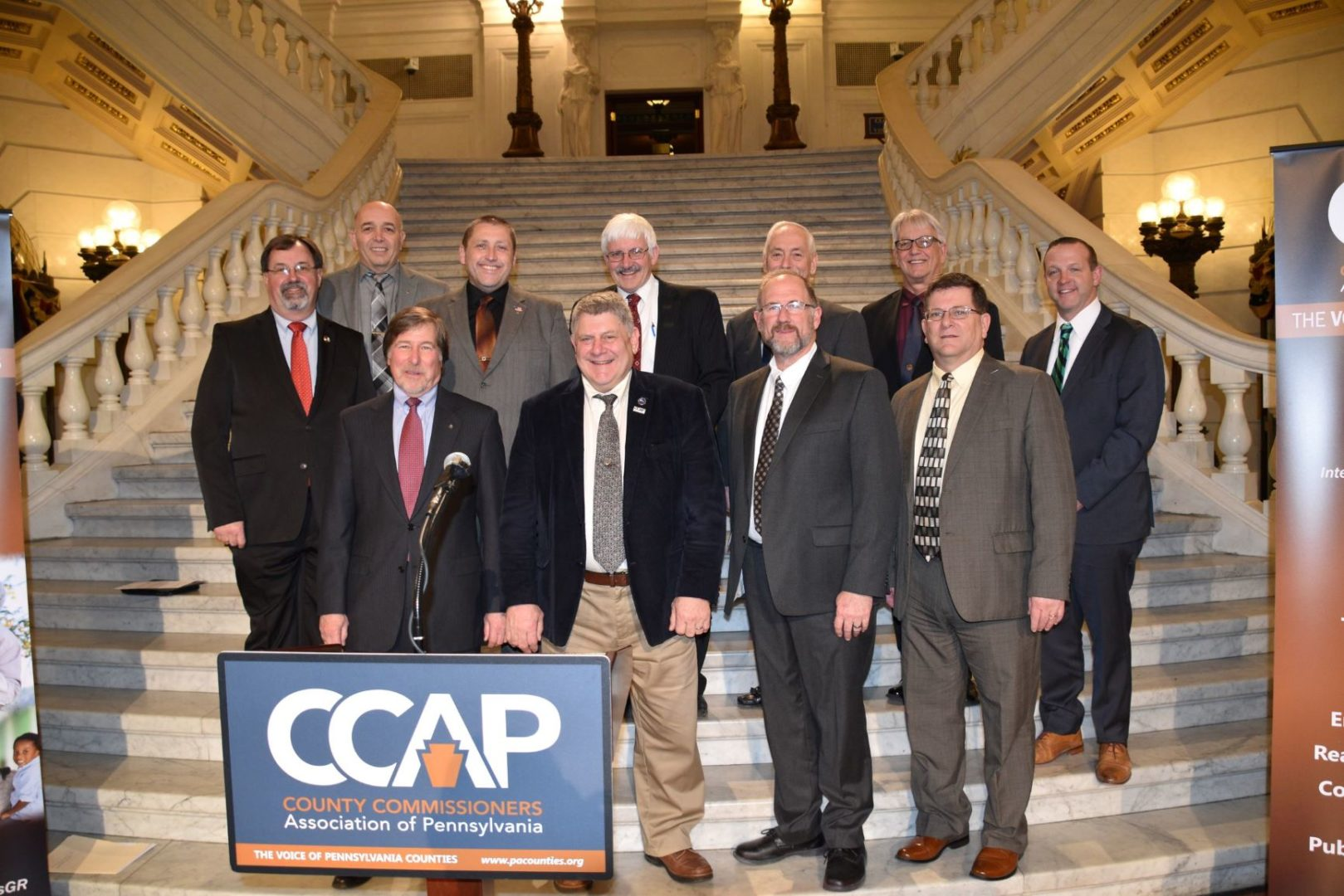 Photo of 11 Pennsylvania County Commissioners at the County Commissioners Association of Pennsylvania conference